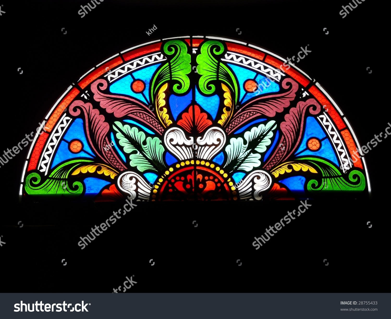 Semi Circular Stained Glass Window In A Church In France