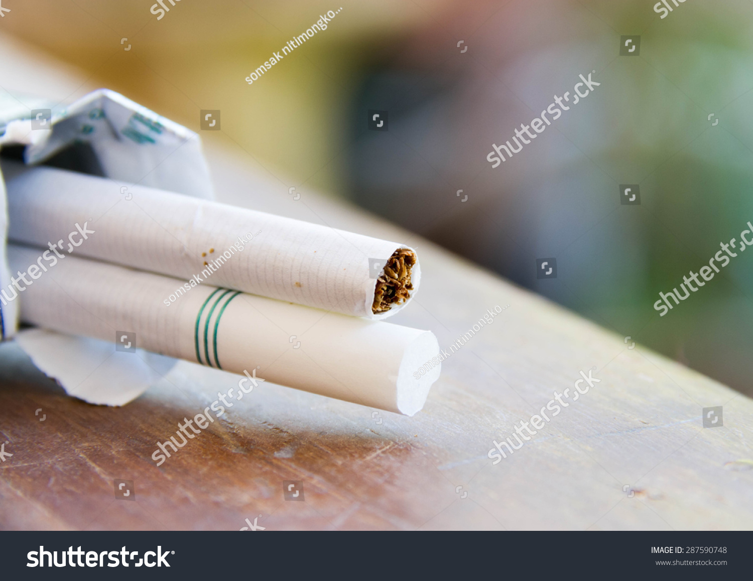 Close cigarettes on wooden table stock photo
