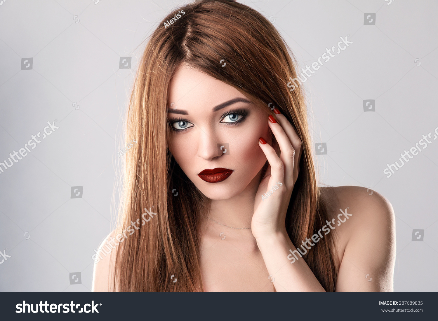 Fashion Beauty Model. Sexy Young Woman On Grey Background