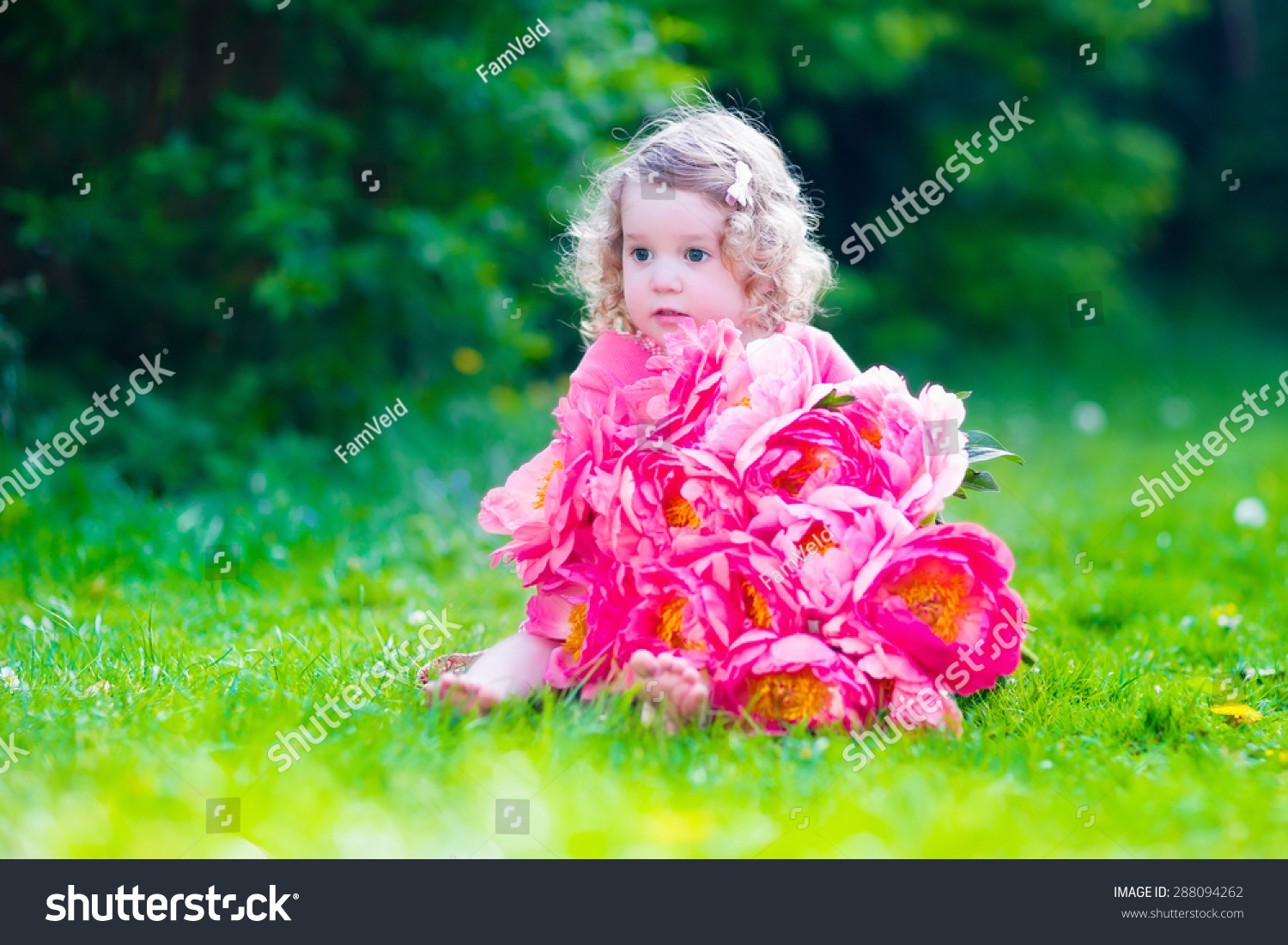 Royalty Free Little Cute Girl With Peony Flowers 288094262 Stock