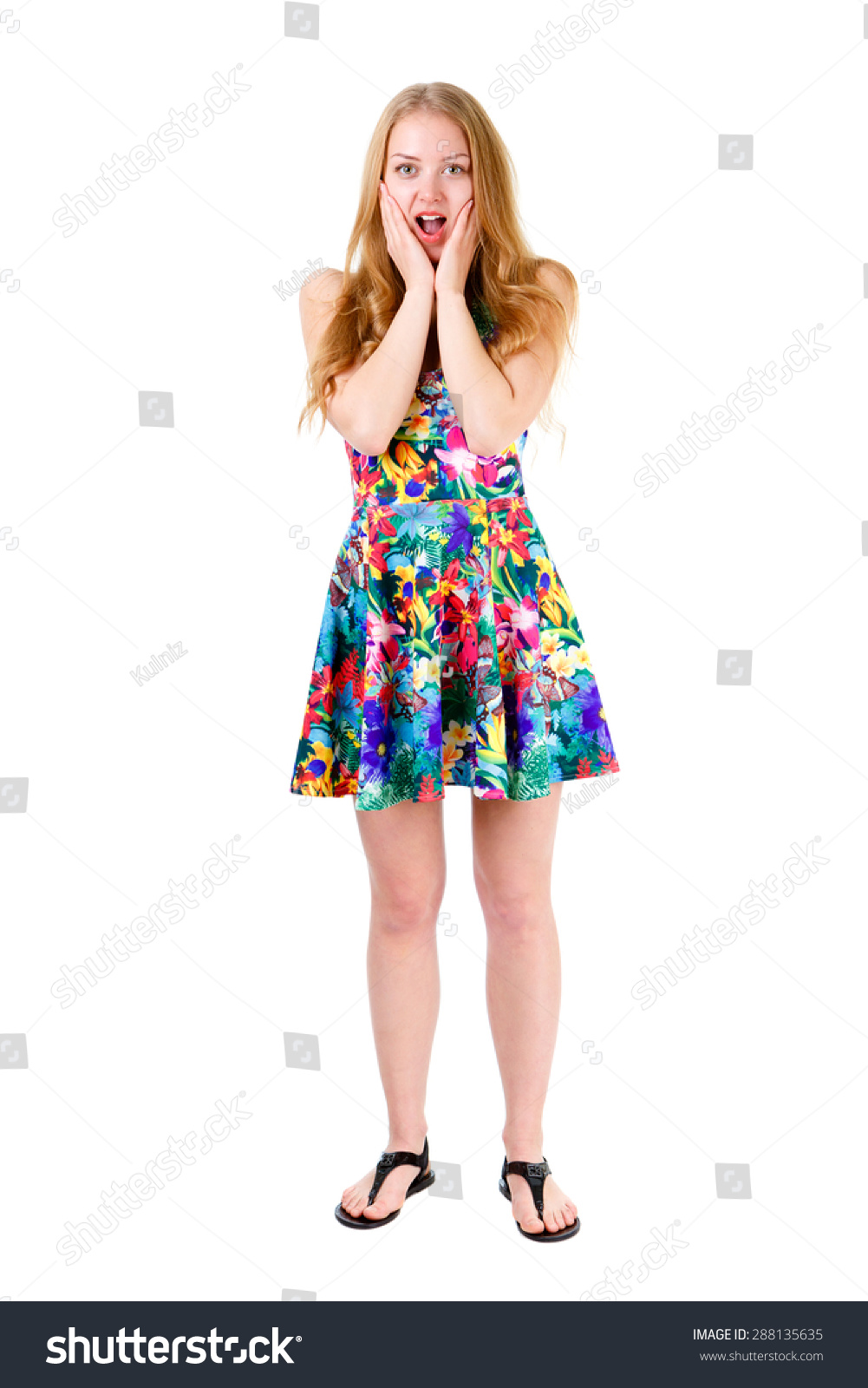 Wondered pretty blonde teenager with wide open eyes and mouth standing and  holding hands near her face. Isolated on white background, human emotion,  ...