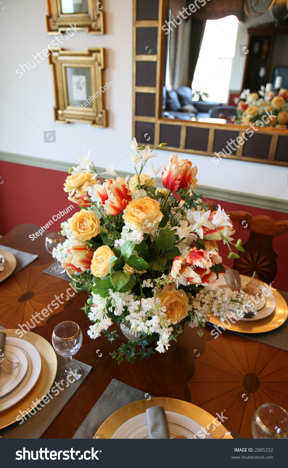 Colorful flower centerpiece on dining room stock photo for Flowers for dining room table