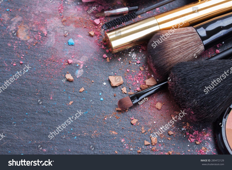 make up set, soft  makeup  brushes and  maskara on black background #289472129