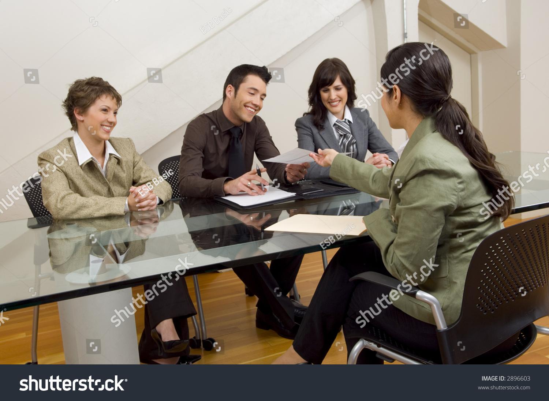 woman handing over resume meeting stock photo 2896603 shutterstock