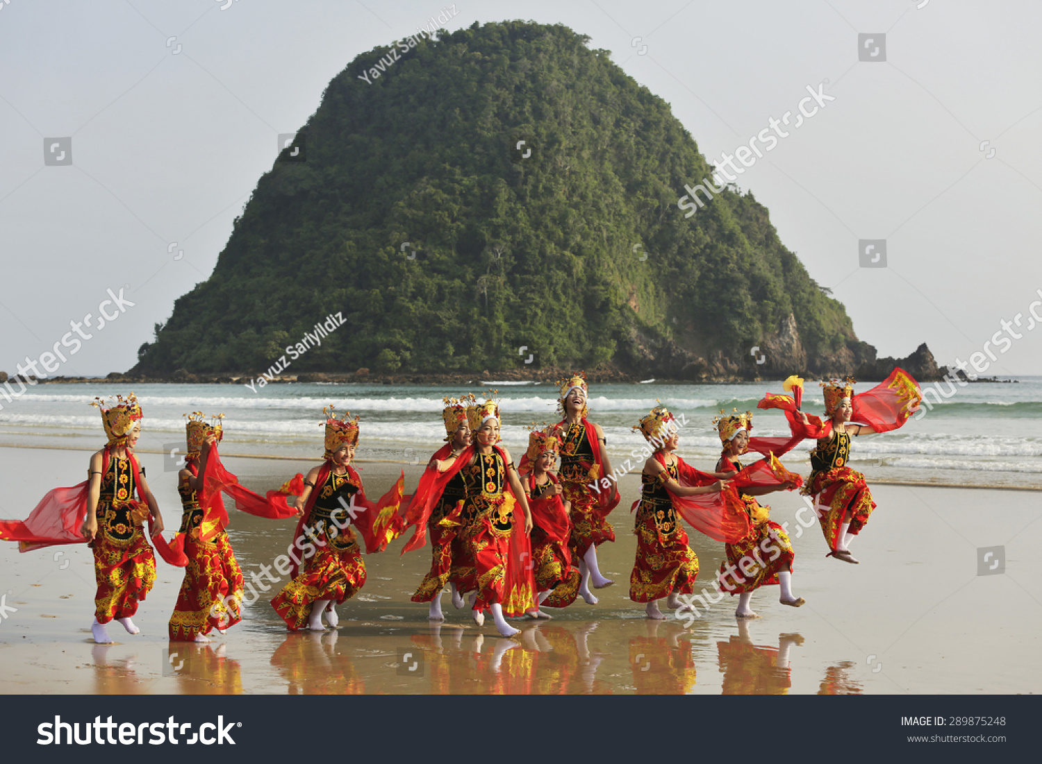 MERAH BEACH BANYUWANGI INDONESIA May 24 2015 Unidentified Indonesia folk dancers perform their traditional folk dance in the coastline of Merah Beach Banyuwangi Indonesia