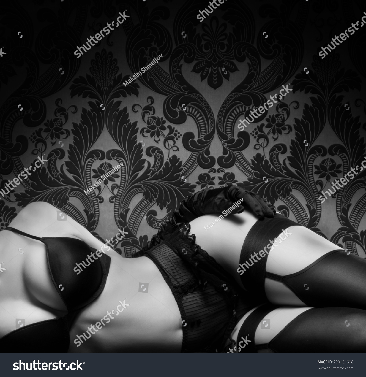 Retro styled black and white photo of a beautiful woman in a vintage sexy lingerie