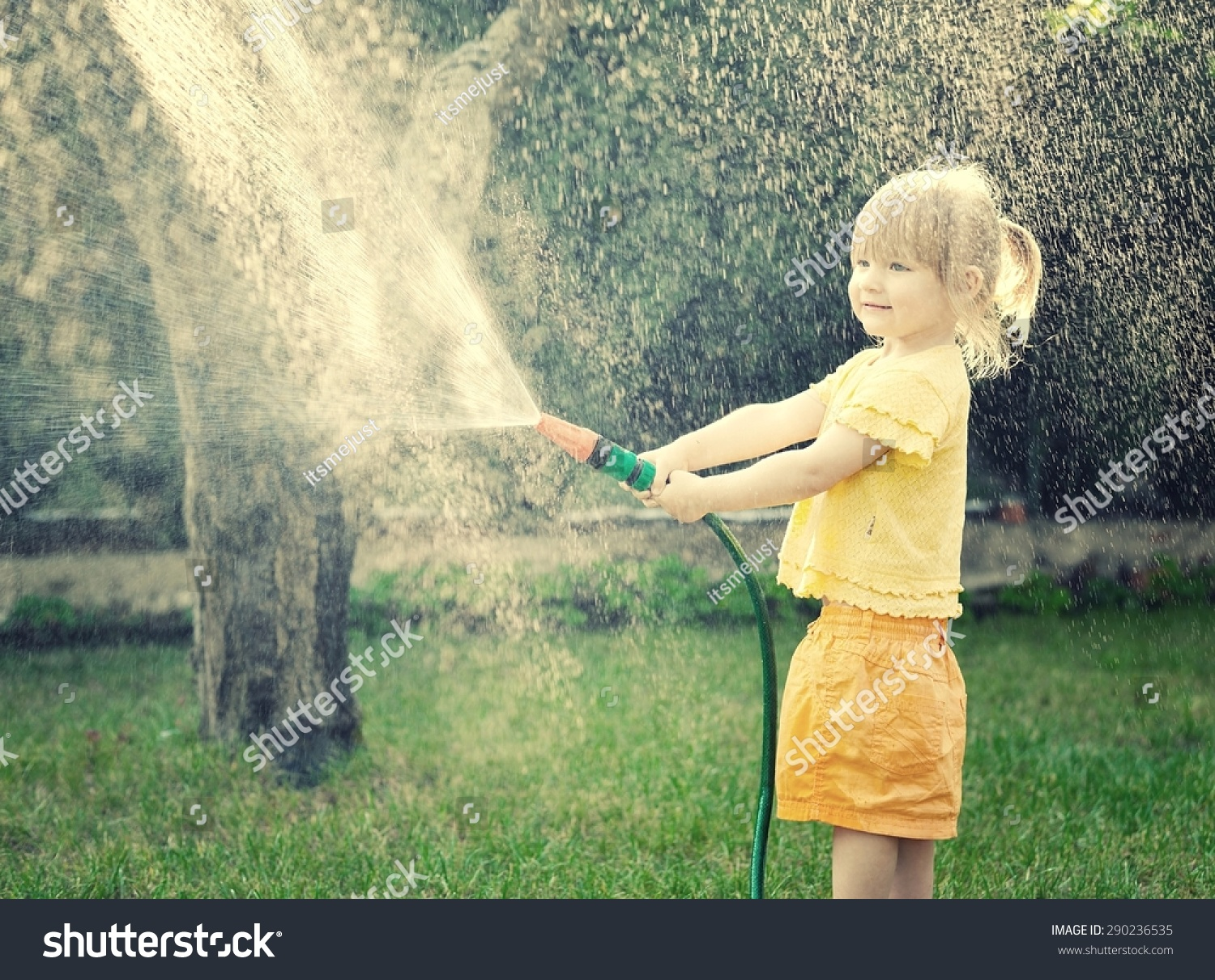little playing garden pouring all stock photo 290236535