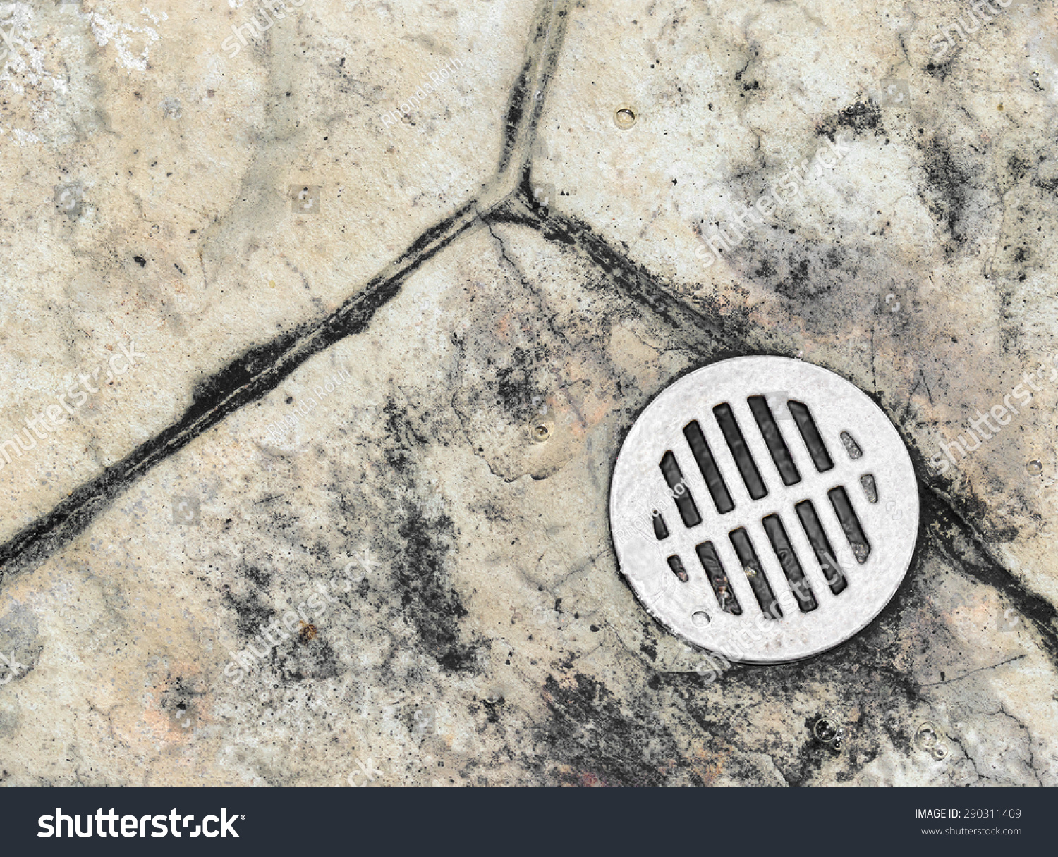 Wet outdoor tile floor drain hole stock photo royalty free wet outdoor tile floor drain hole close up water draining down a metal drain cover dailygadgetfo Image collections