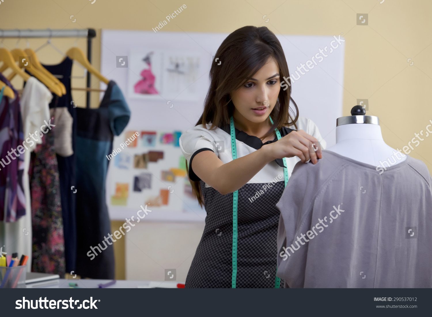 Young Female Fashion Designer Working On Stock Photo ...