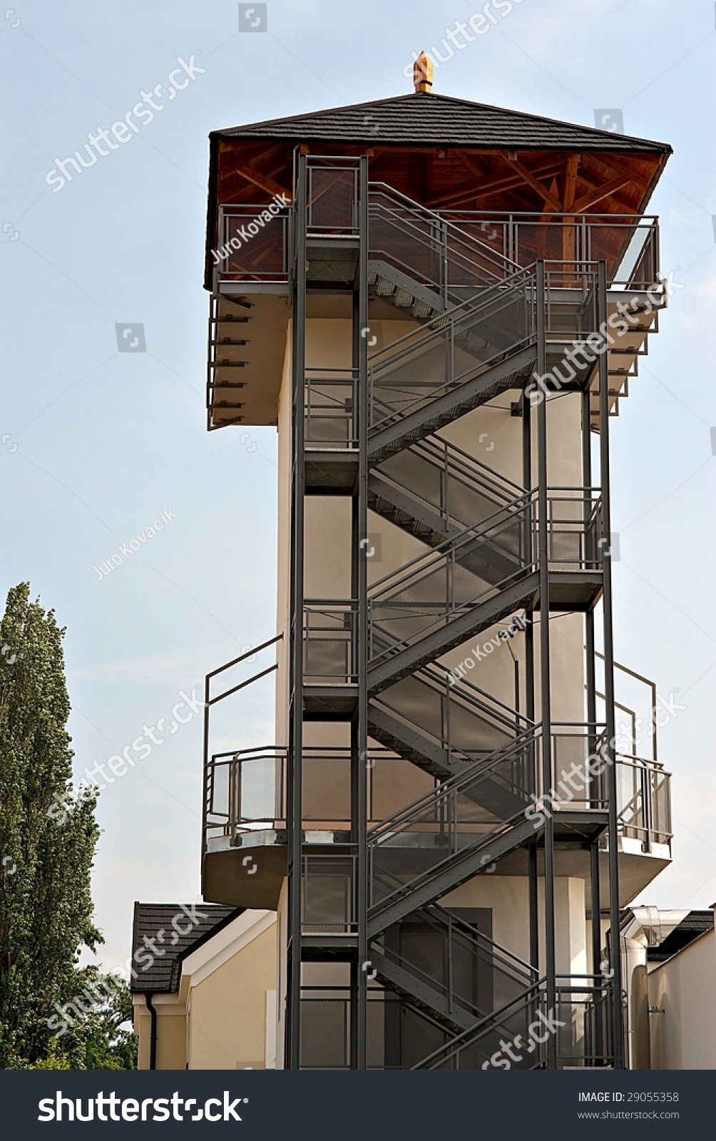 Tower With Metal Outside Staircases And Wooden Roof