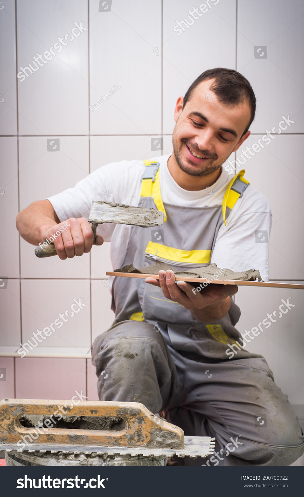 Floor Tile Workers : Industrial tiler builder worker installing floor stock
