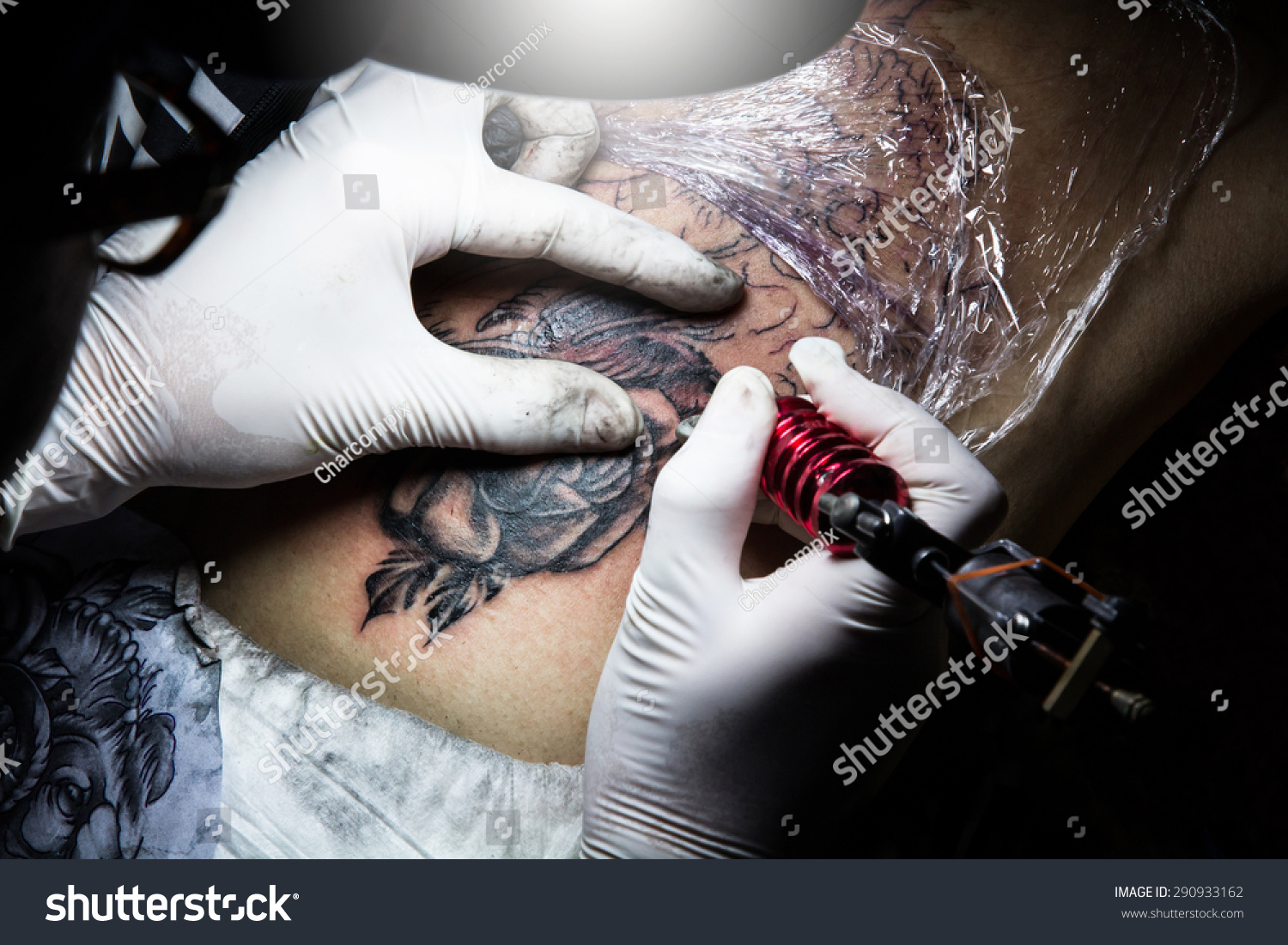 Tattooer showing process making tattoo tattoo stock photo for Process of tattooing