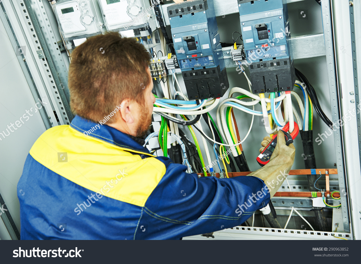 Adult Electrician Builder Engineer Making Electrical Stock Photo Wiring A Fuse Board Measure With Equipment In Fuseboard