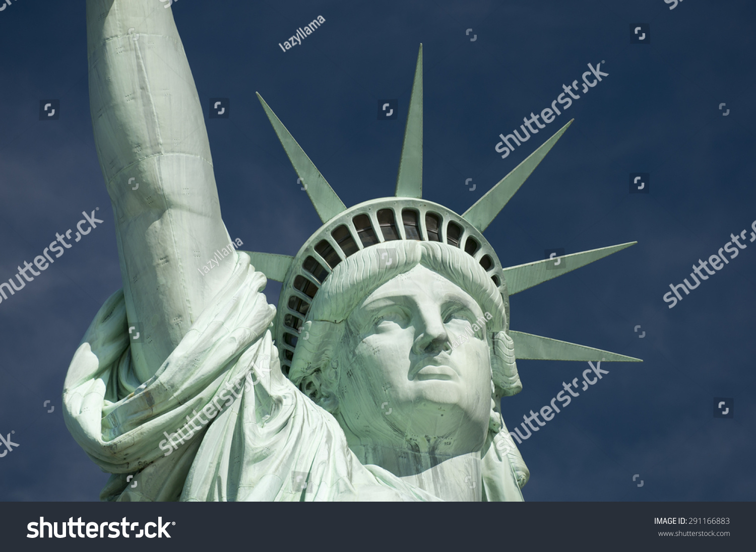 Closeup statue liberty face crown against stock photo 291166883 close up of the statue of liberty face and crown against deep blue sky buycottarizona Gallery
