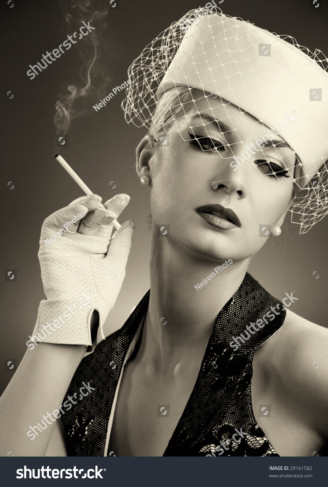 Beautiful Smoking Woman. Retro Portrait Stock Photo