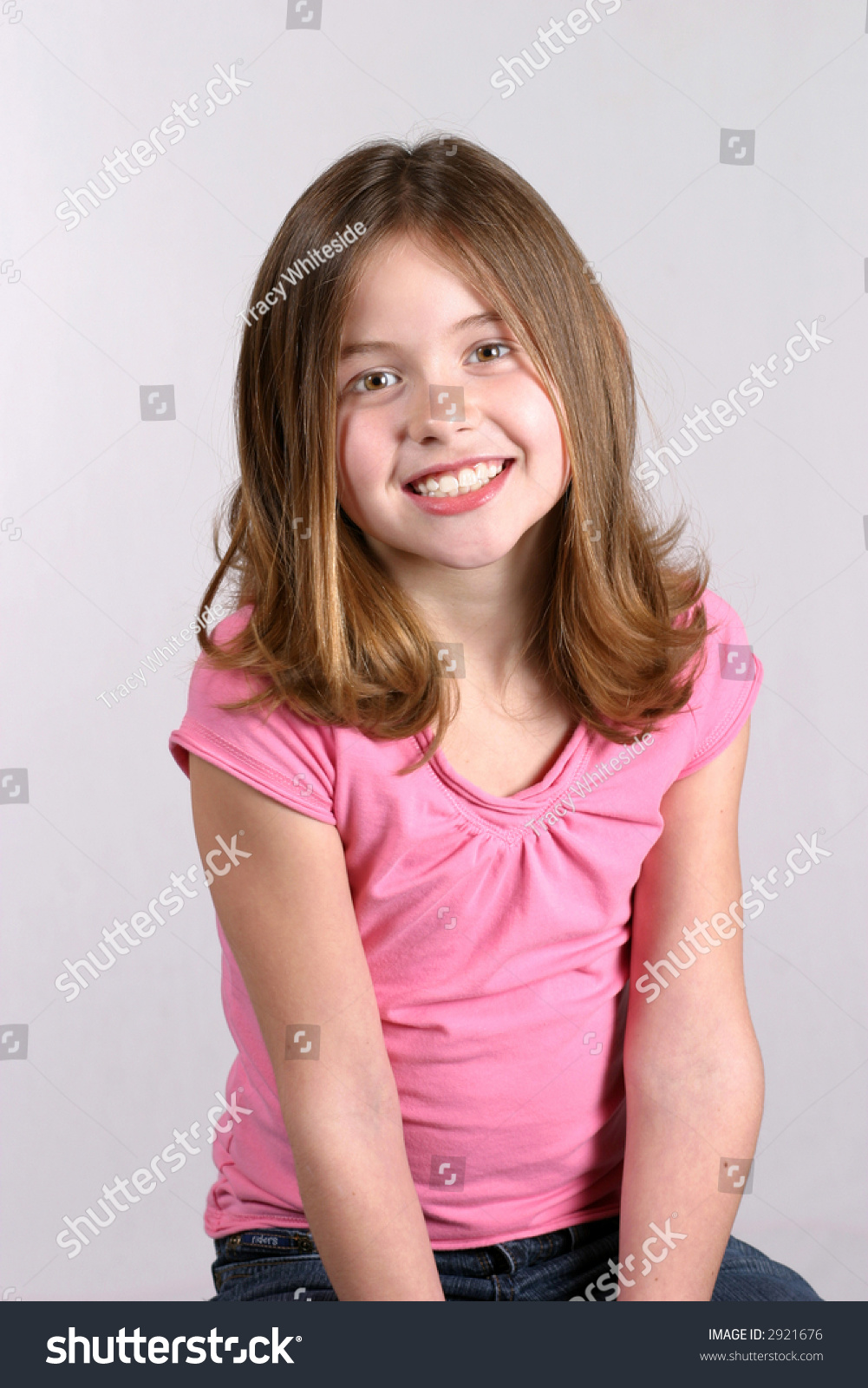 Pre Teen Model Gallery: Pretty Young Preteen Girl Pink Shirt Stock Photo 2921676