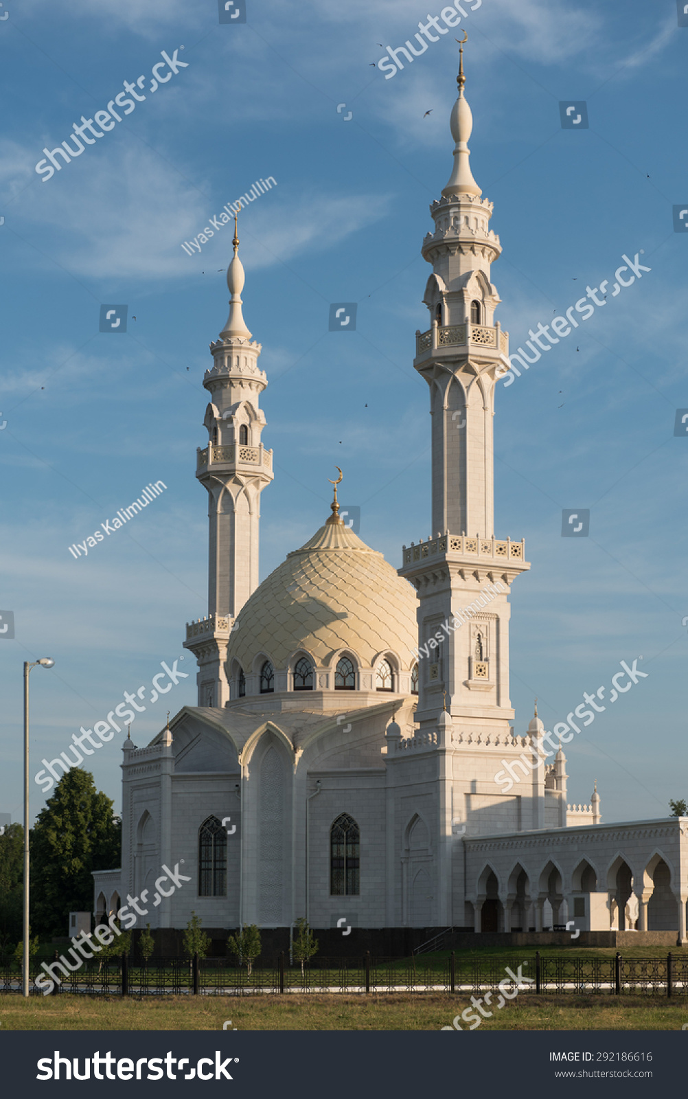 bahrain, manama. the kanoo mosque beautiful twin minarets reflect