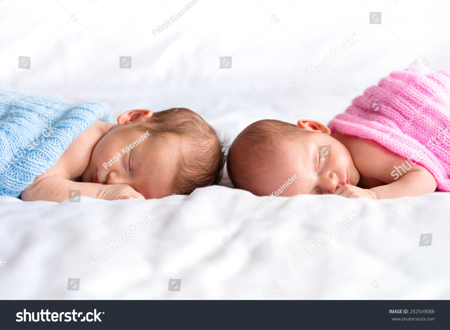 Boy and girl twins lying down in bed stock photo 292549088 for Boys and girls in bed