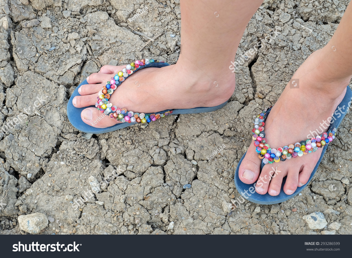 Woman Foot Colorful Slippers On Crack Stock Photo (Edit Now