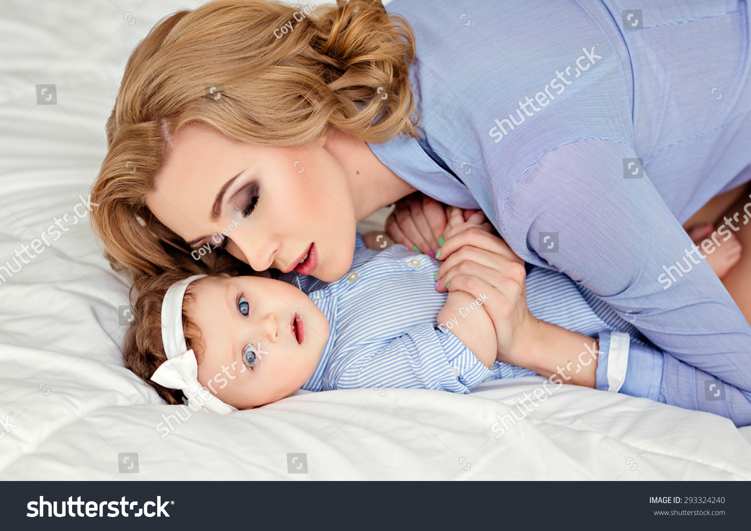 portrait beautiful mom blonde little girl stock photo (edit now