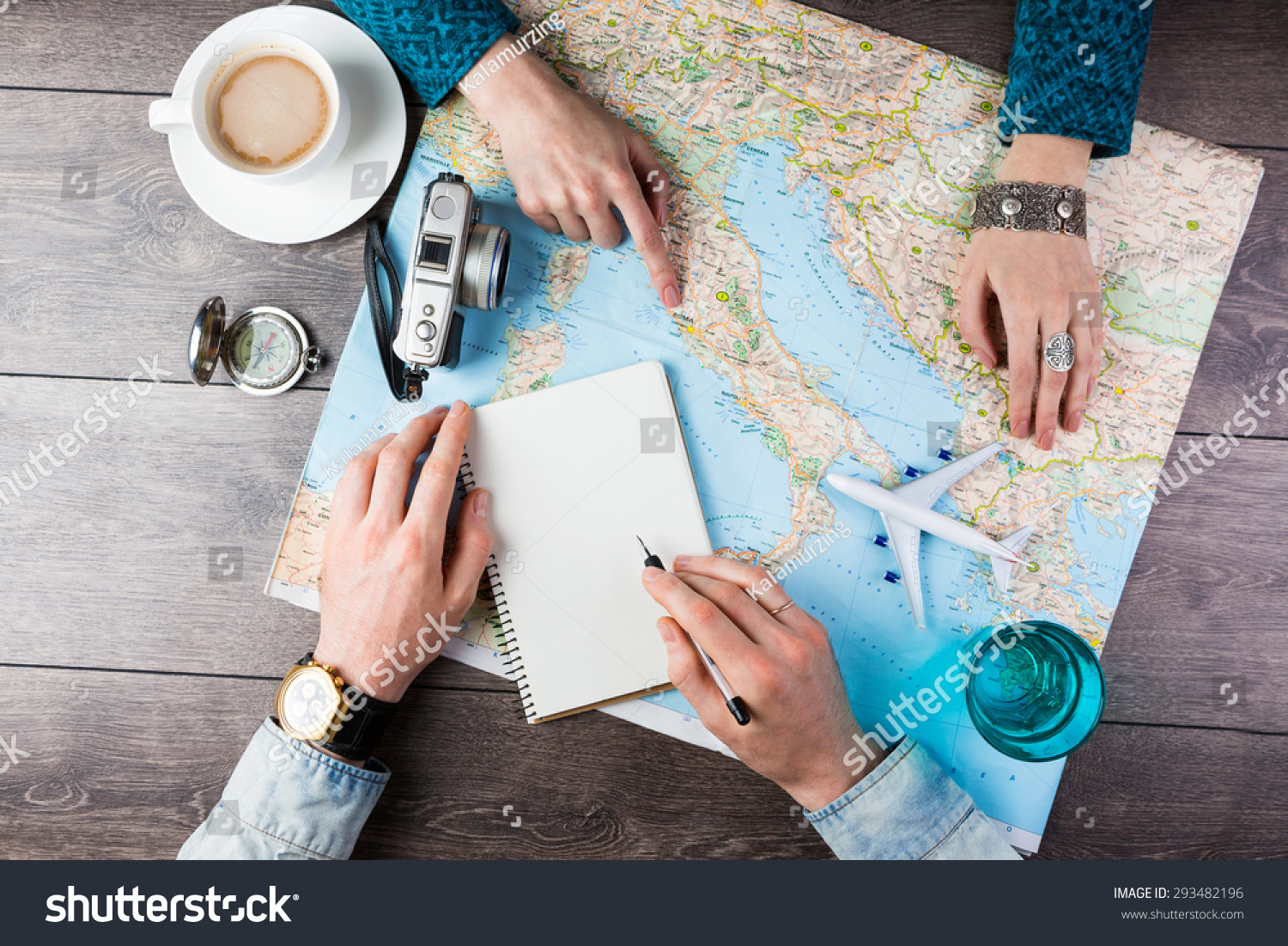 two young people together planning trip stock photo