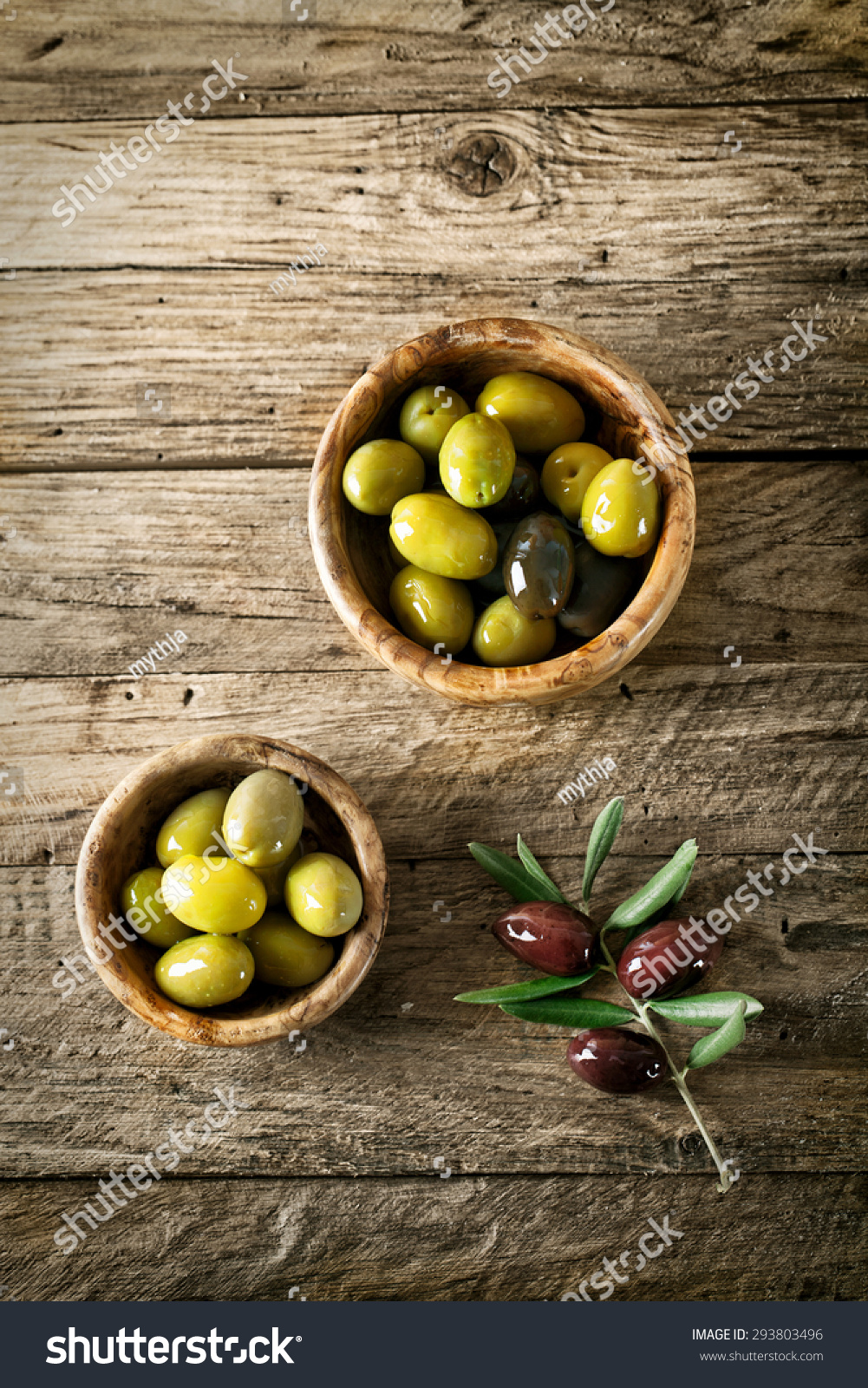 olives on old wood Wooden table with olives and olive oil