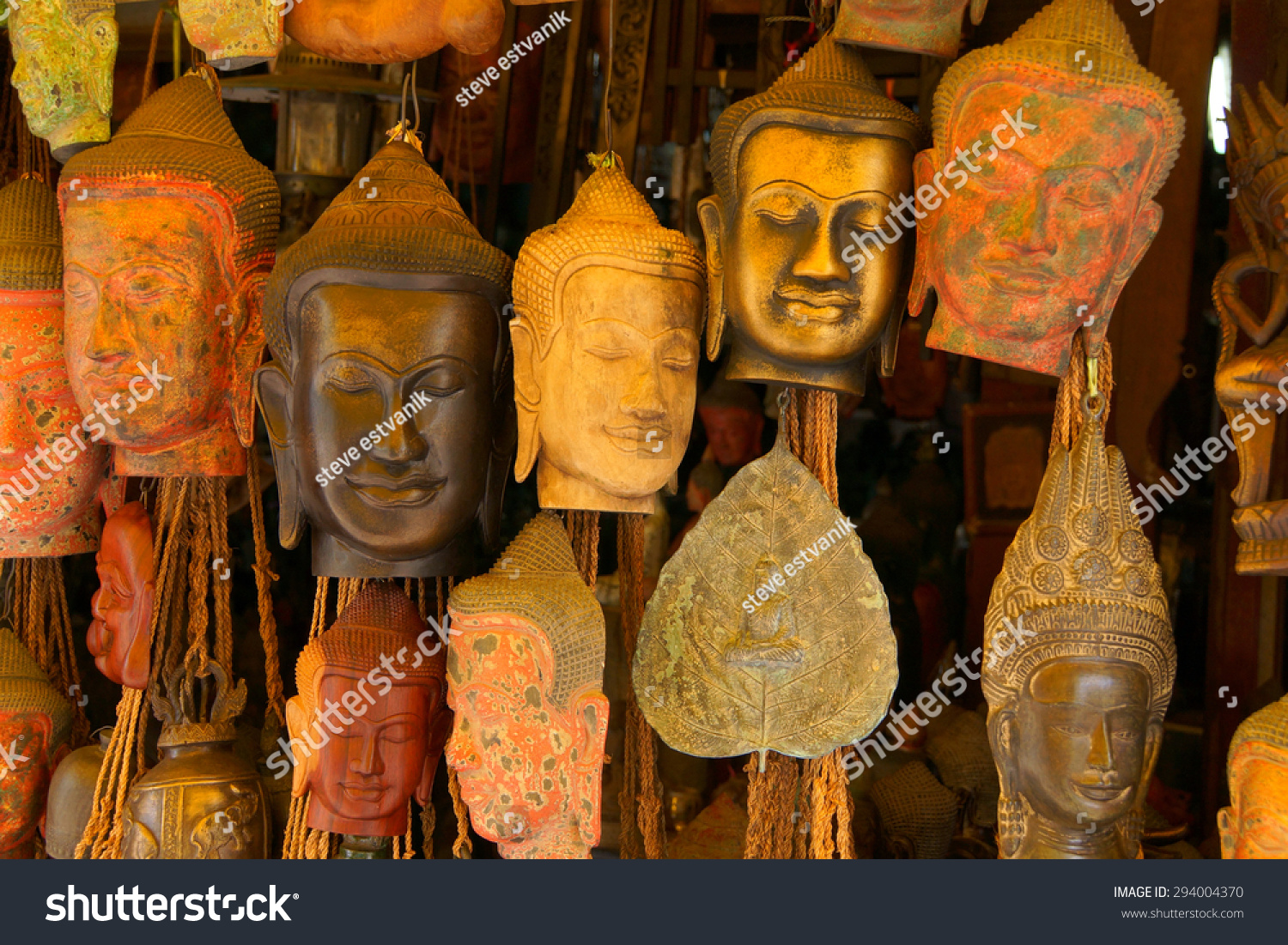Buddha head masks and carvings old market siem reap
