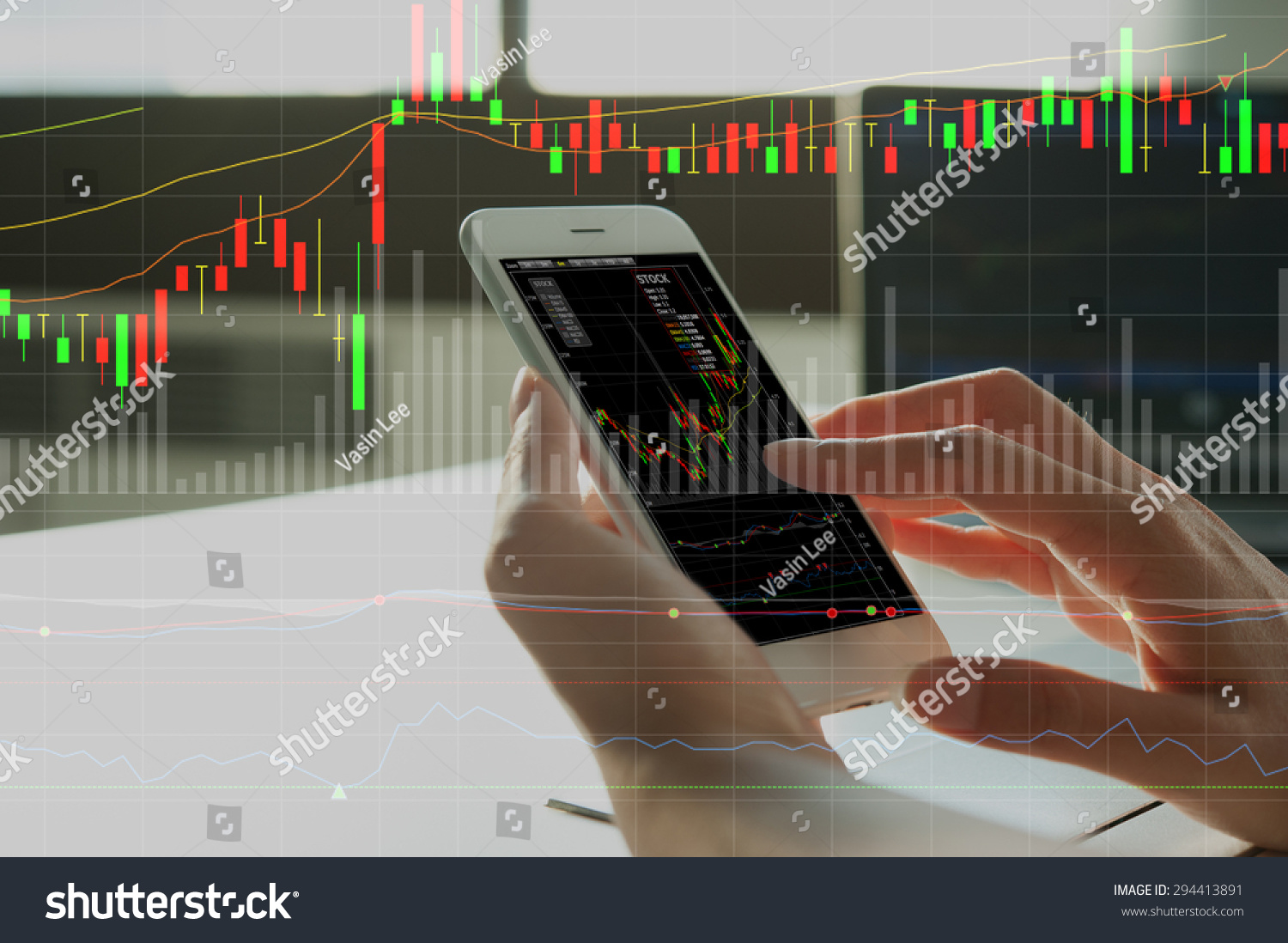 woman's hand using smart phone with digital layer of financial graph #294413891