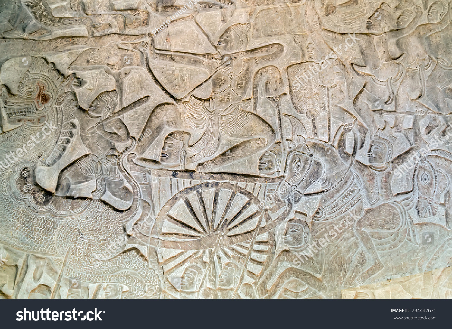 Khmer relief carving of gods fighting demons inner wall