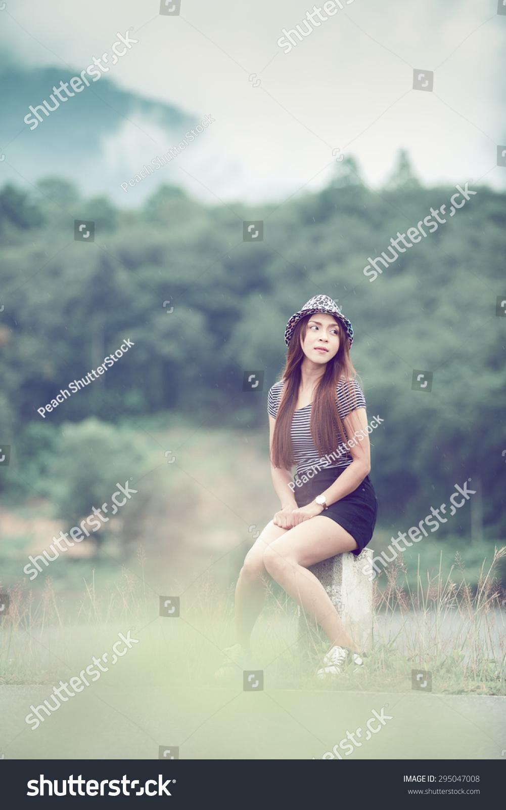 Beautiful girl sitting alone