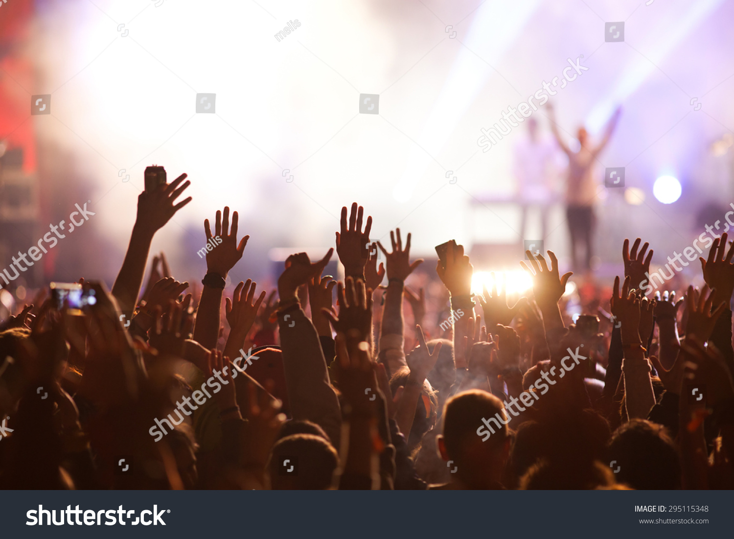 Crowd at concert and blurred stage lights #295115348