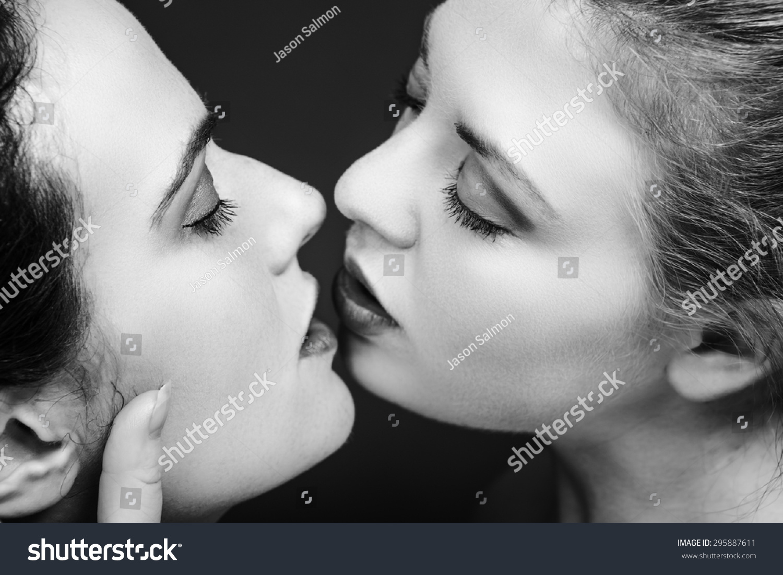 Black and white lesbians kissing