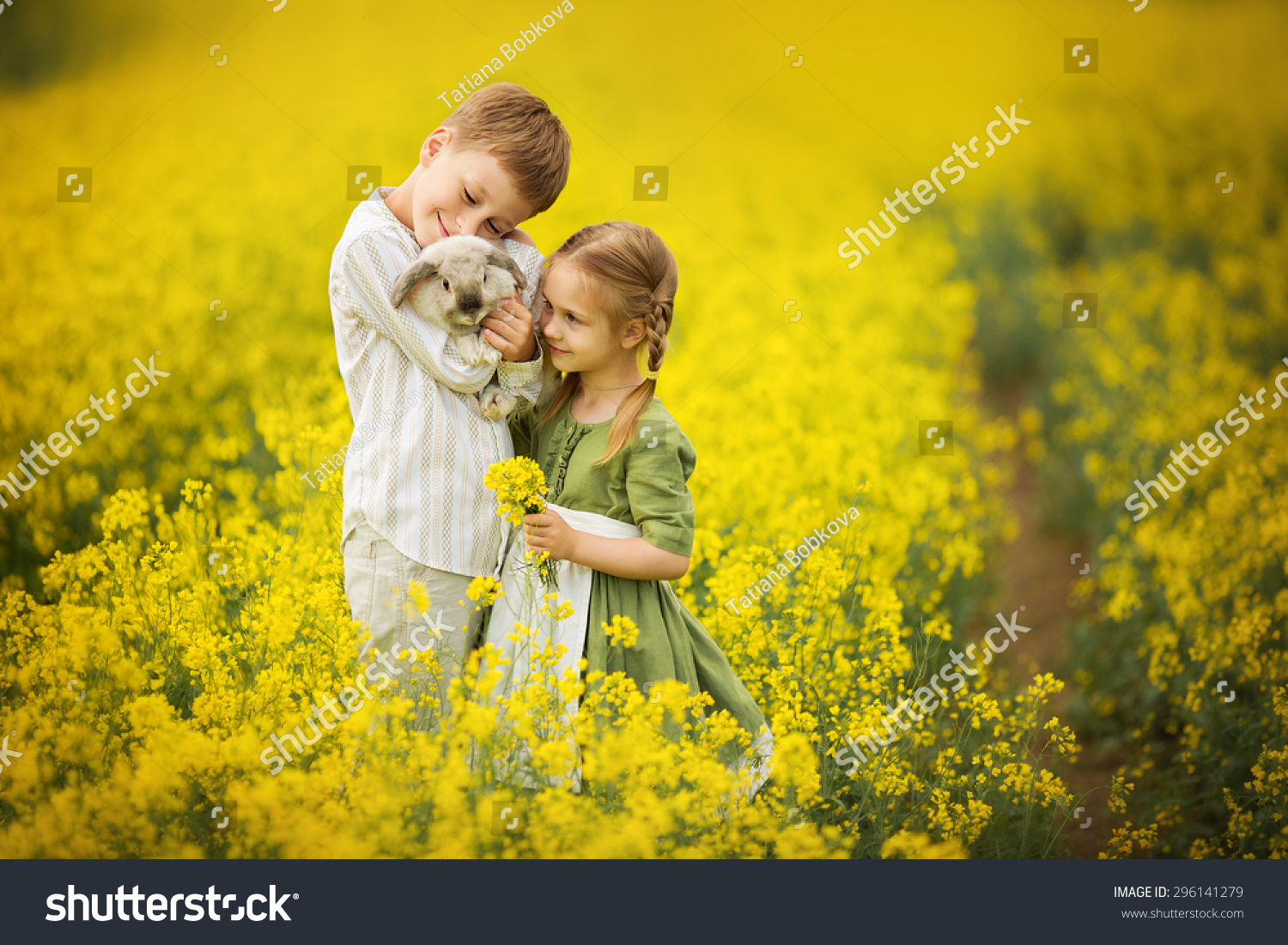 White apron girl - Little Pretty Girl In Green Dress With White Apron And Young Boy Holding A Rabbit In