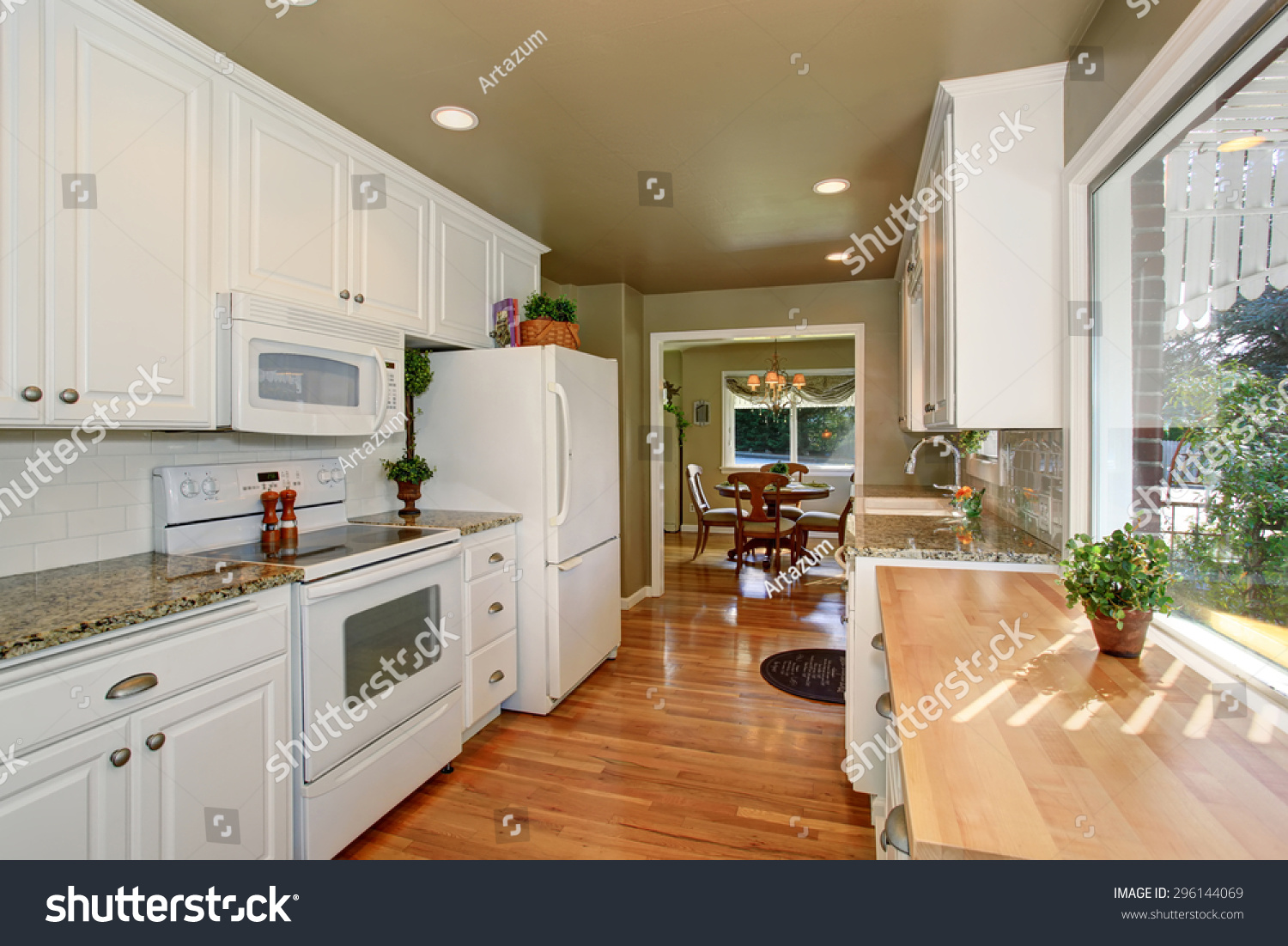 State Of The Art Kitchen With Green Walls And White Accents.