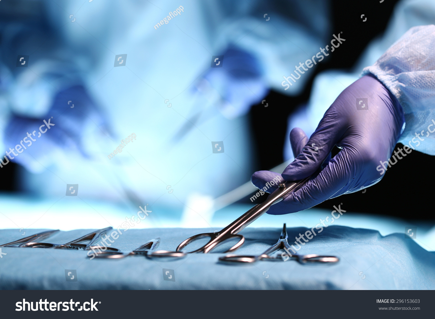 nurse hand taking surgical instrument group stock photo