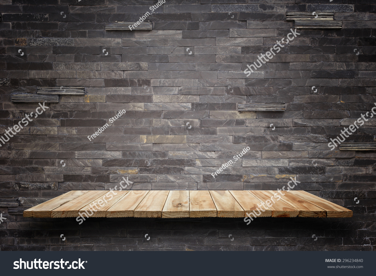 Empty top wooden shelves and stone wall background For product display