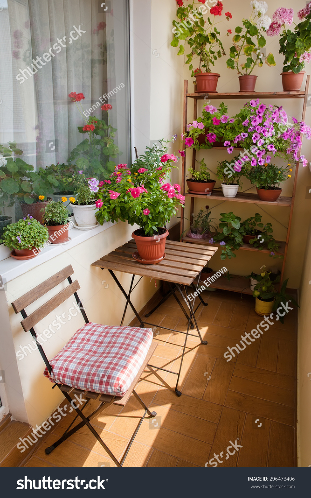 Beautiful balcony small table chair flowers stock photo for Small balcony table and chairs