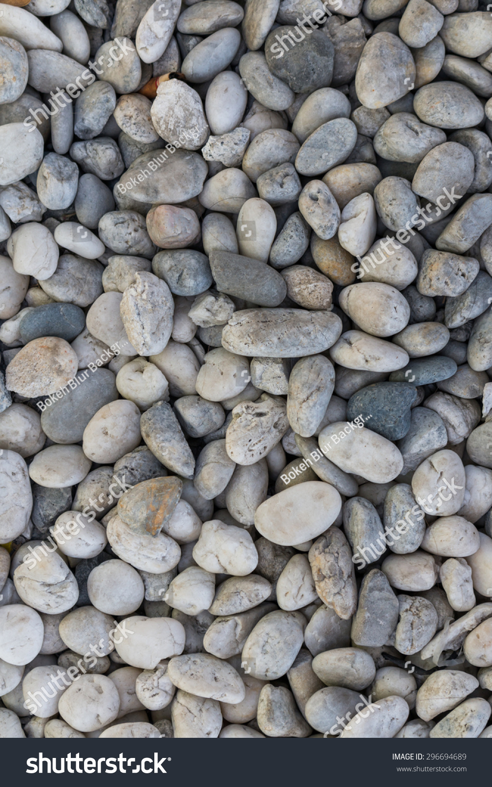 Smooth shaped white stones surface texture background stock photo - White River Stone Texture Background