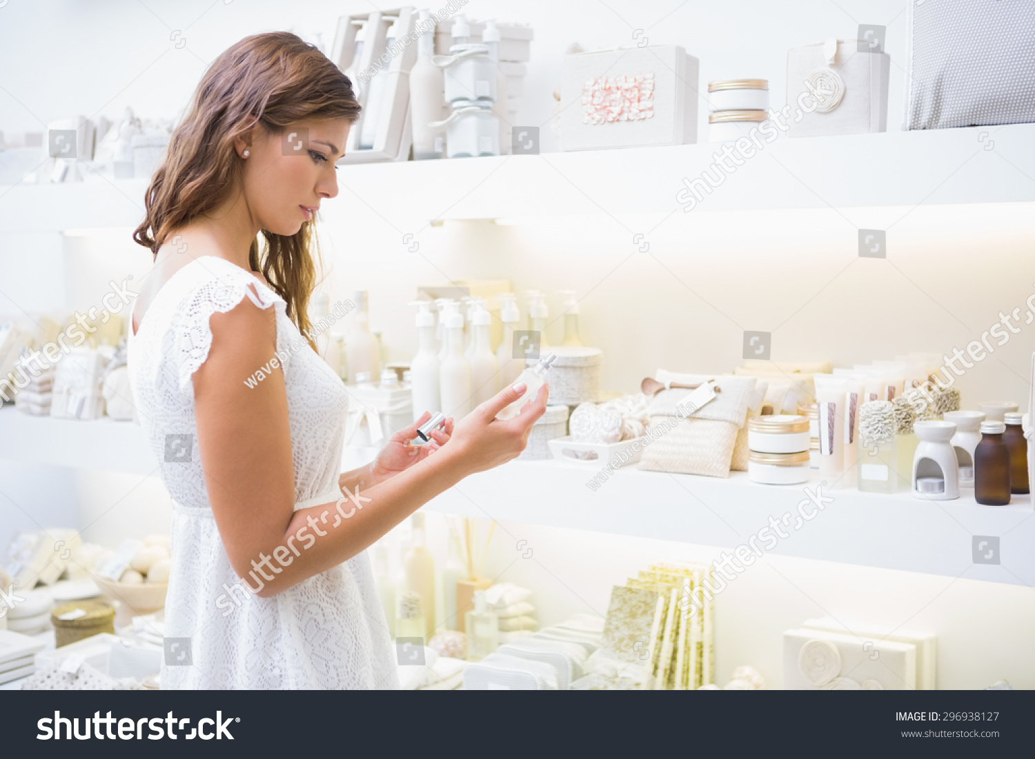 Concentrated woman reading ingredients beauty salon stock for Reading beauty salon