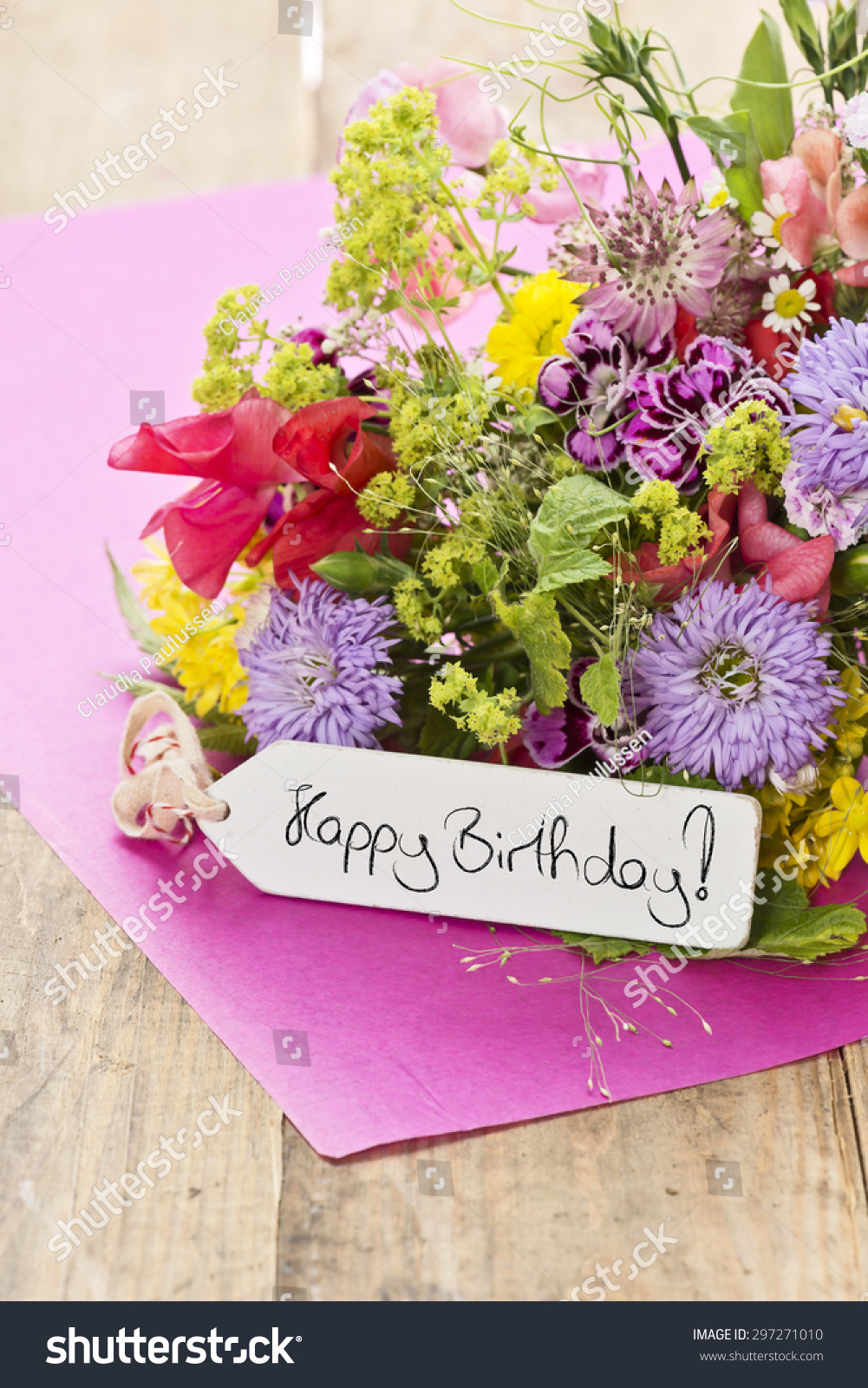 Close bouquet flowers label saying happy stock photo edit now a close up of a bouquet of flowers with a label saying happy birthday izmirmasajfo