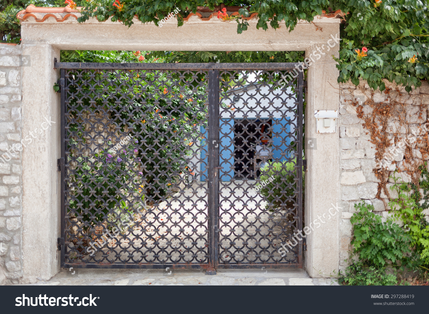 rather old and handcrafted gateway doors in the best Mediterranean tradition; nice metal pattern and & Rather Old Handcrafted Gateway Doors Best Stock Photo (Edit Now ...