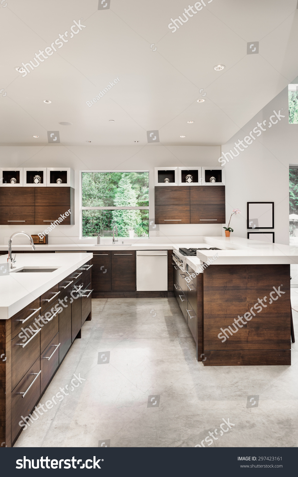 kitchen in luxury home with oak cabinets stock photo   Kitchen In New Luxury Home With Island, Sink, Cabinets ...