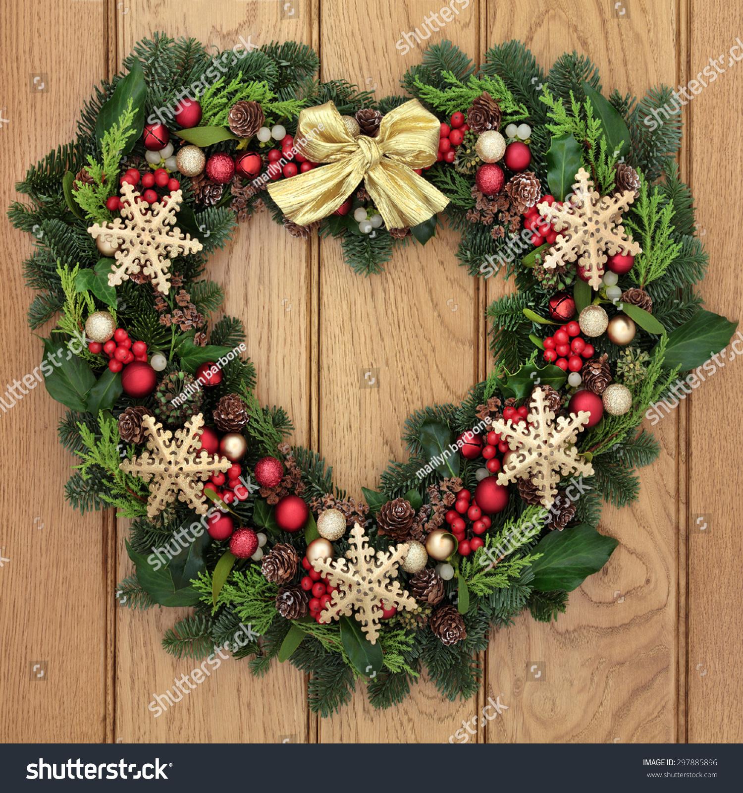Christmas heart shaped wreath gold snowflake stock photo 297885896 christmas heart shaped wreath with gold snowflake bauble decorations bow holly mistletoe and rubansaba