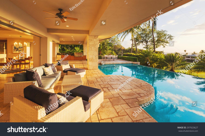 Beautiful luxury home swimming pool sunset stock photo for Beautiful house with swimming pool