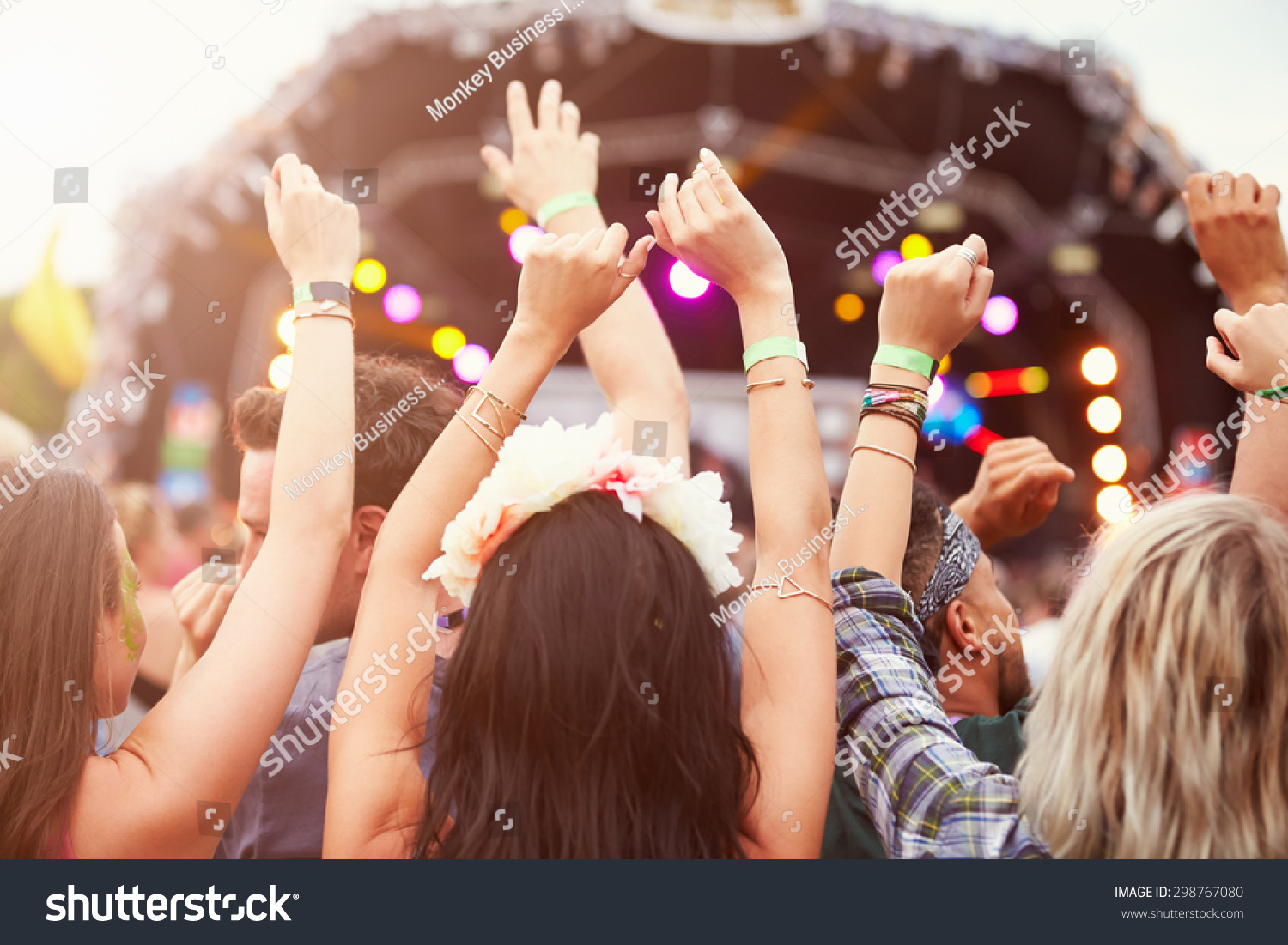 Audience with hands in the air at a music festival #298767080