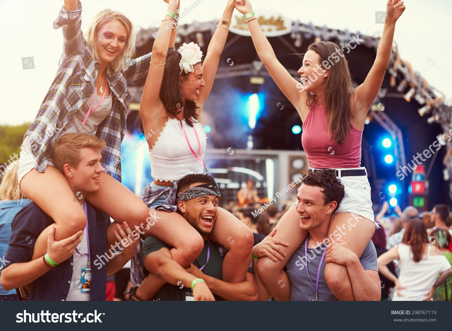 Friends having fun in the crowd at a music festival #298767119