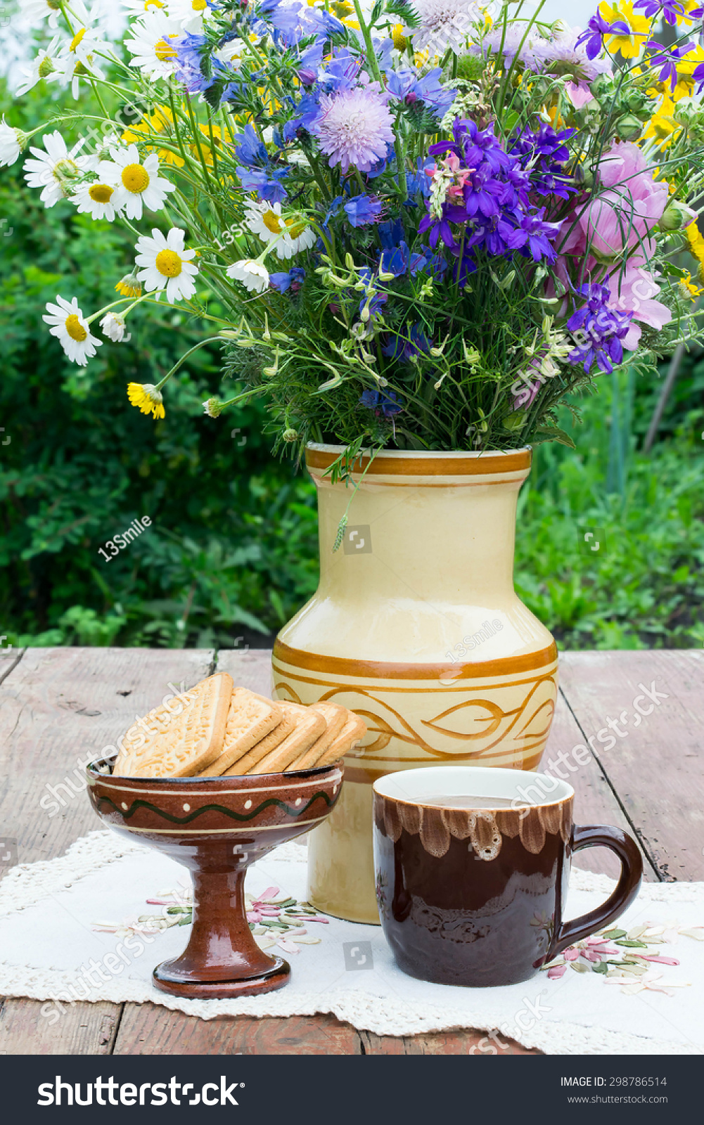 Herbal tea biscuits and a bouquet of wild flowers in a ceramic vase id 298786514 izmirmasajfo