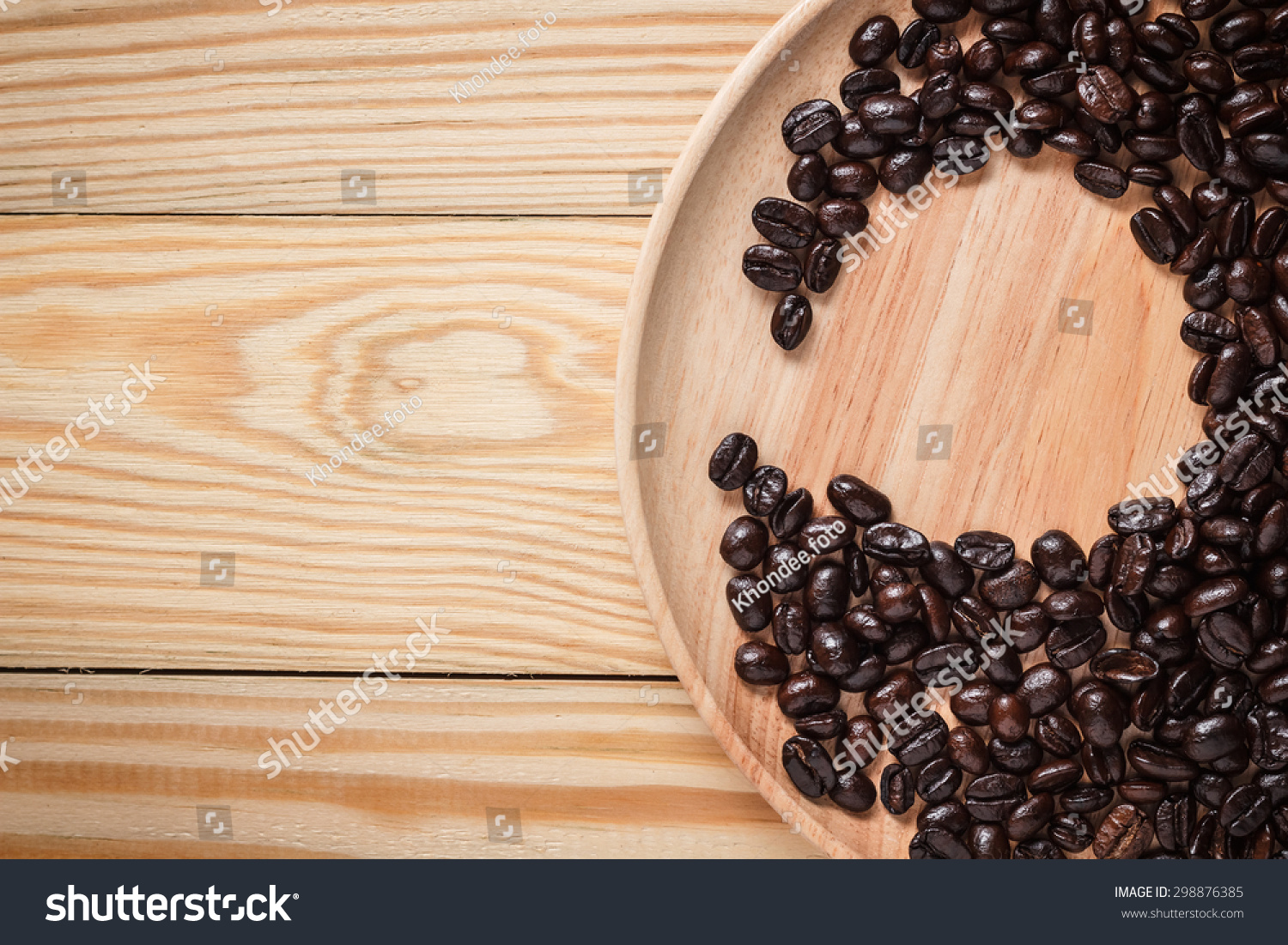 Top view Coffee bean were placed on a wooden plate
