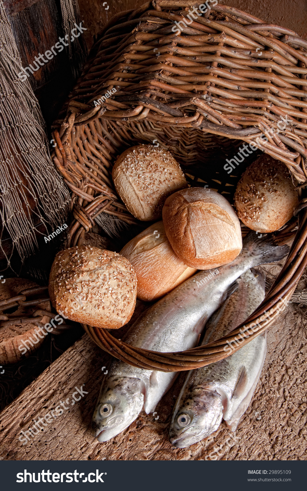 Religious still life of loaves of bread fishing net for Loaves and fish