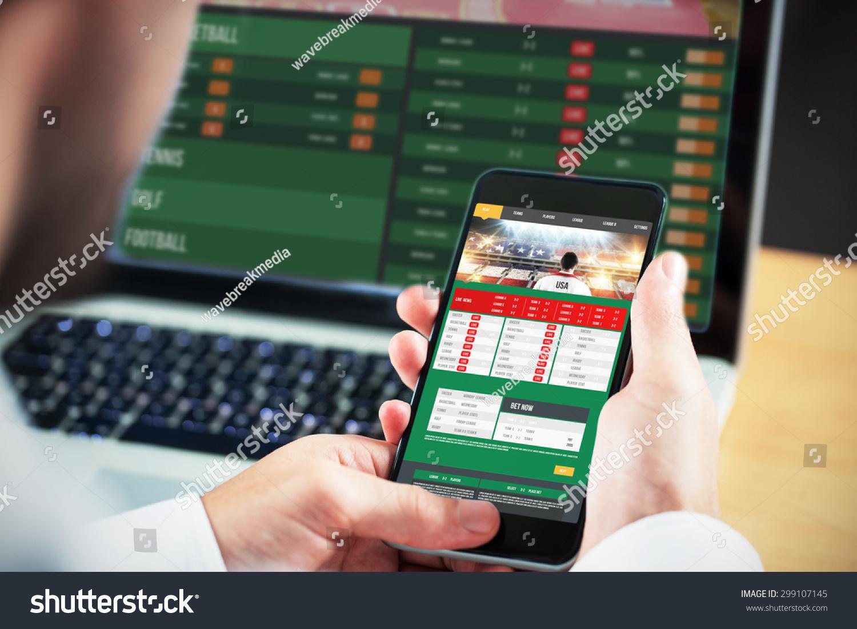 Businessman using smartphone against gambling app screen #299107145